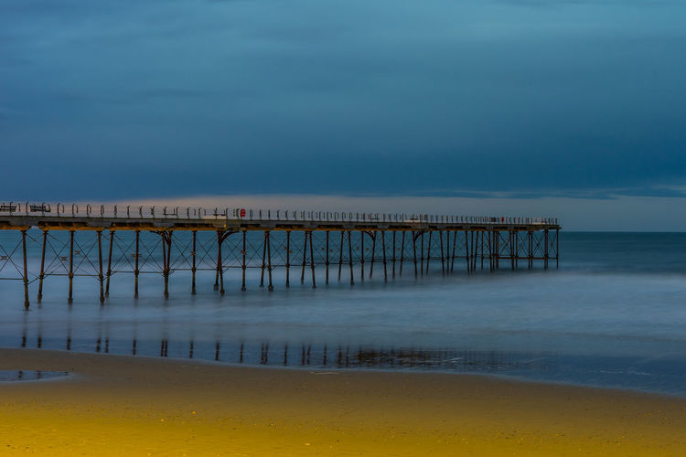 Saltburn pier. North east coast of England. Slow shutter speed. Water Sky Sea Architecture Built Structure Pier Nature Cloud - Sky No People Outdoors Architectural Column Piers North East Teesside Saltburn Yorkshire England Uk Europe European  Wooden Wooden Structure Seaside Tourism Nature
