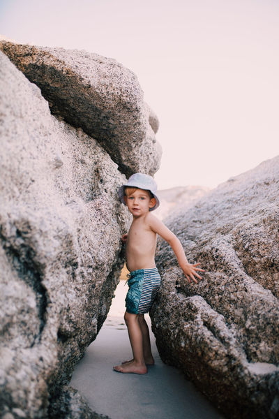 Rock Rock - Object Solid Childhood Child One Person Full Length Day Leisure Activity Nature Shirtless Real People Portrait Rock Formation Hat Lifestyles Sky Clear Sky Outdoors Innocence