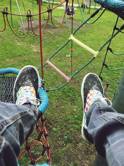 Breathing Space Low Section Shoe Playground Human Leg Childhood Two People Leisure Activity Personal Perspective Casual Clothing Outdoor Play Equipment Real People High Angle View Togetherness Day Grass Human Body Part Park - Man Made Space Standing Playing Outdoors Park Get Away Step Zone