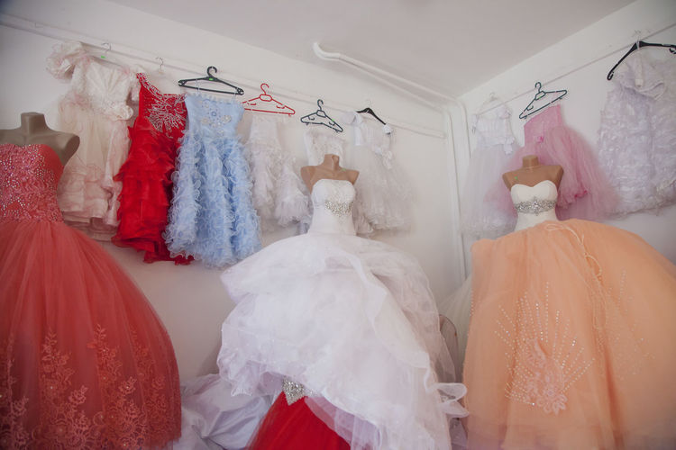 Bridal Shop Bride Celebration Child Marriage Coathanger Day Early Marriage Evening Gown Hanging Indoors  Life Events People Variation Wedding Wedding Dress Wedding Dresses Wedding Shop
