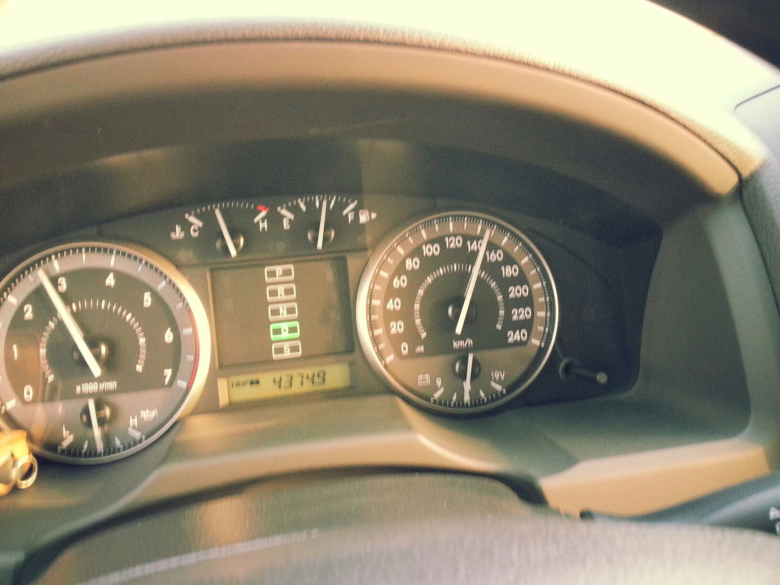 indoors, transportation, mode of transport, land vehicle, car, close-up, reflection, communication, vehicle interior, text, car interior, technology, number, selective focus, retro styled, travel, part of, old-fashioned, speedometer, no people