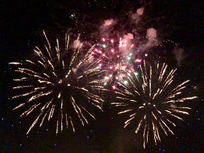 Firework Night Firework Display Celebration Arts Culture And Entertainment Event Exploding Illuminated Glowing Motion Low Angle View Long Exposure Smoke - Physical Structure Multi Colored Firework - Man Made Object Outdoors Light