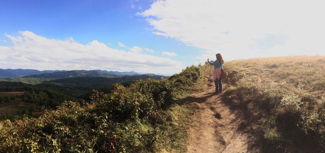 Hiking fun in Asheville. Leisure Activity Mountain Landscape Full Length Sky Lifestyles Standing Nature Remote Beauty In Nature Tranquil Scene Tranquility Plant Hiking Scenics Cloud - Sky Day Growth Solitude Woman Dog