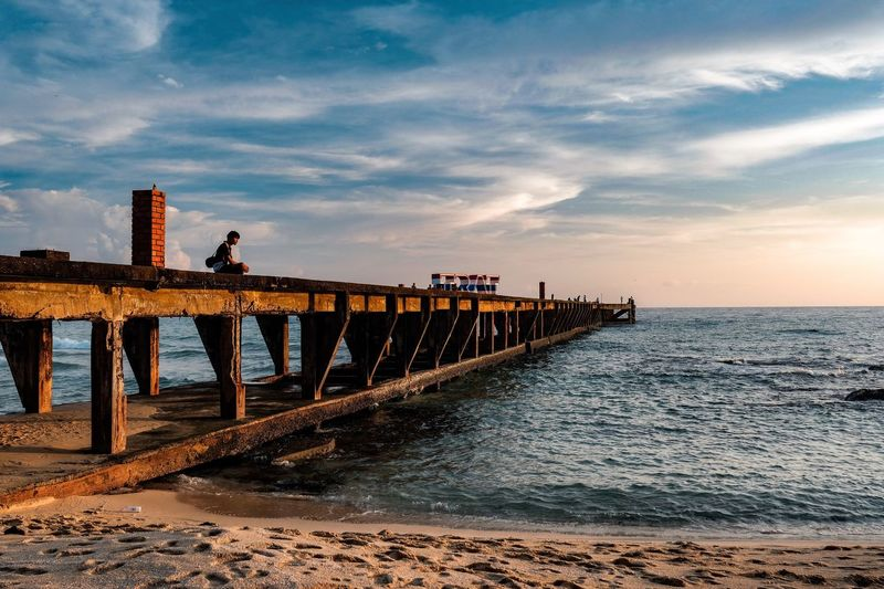 Sunset Cloud - Sky Sky Water Bridge - Man Made Structure Sunset Sea Nature Outdoors Scenics Built Structure Architecture Real People Day Full Length Horizon Over Water Men Beauty In Nature One Person People Jetty Landing The Great Outdoors - 2017 EyeEm Awards