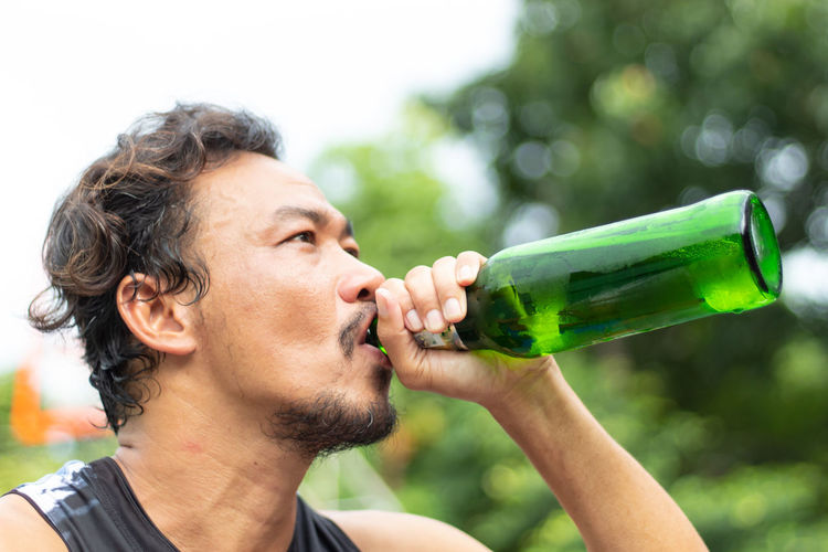 Close-up of man drinking beer
