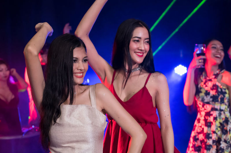 Night Nightlife Happiness Young Adult Enjoyment Fun Young Women Group Of People Nightclub Smiling Women Arts Culture And Entertainment Emotion Dancing Adult Fashion Togetherness Friendship Indoors  Arms Raised Human Arm Beautiful Woman Limb Body Part Human Limb
