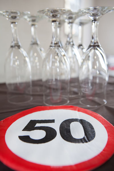 50 anniversary and champagne glasses 50 Alcohol Anniversary Birthday Celebration Champagne Close-up Decoration Drink Event Fifty Glass Glasses Indoors  No People Party Red Sign Speed Limit Traffic Upside Down
