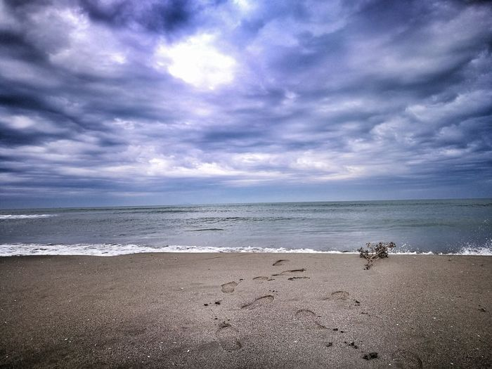 Sea Beach Horizon Over Water Cloud - Sky Scenics Sky Beauty In Nature Outdoors Tranquility Tranquil Scene Nature Sand Water Footsteps In The Sand Footsteps Cloudy Sky Winter Sea Beauty In Nature