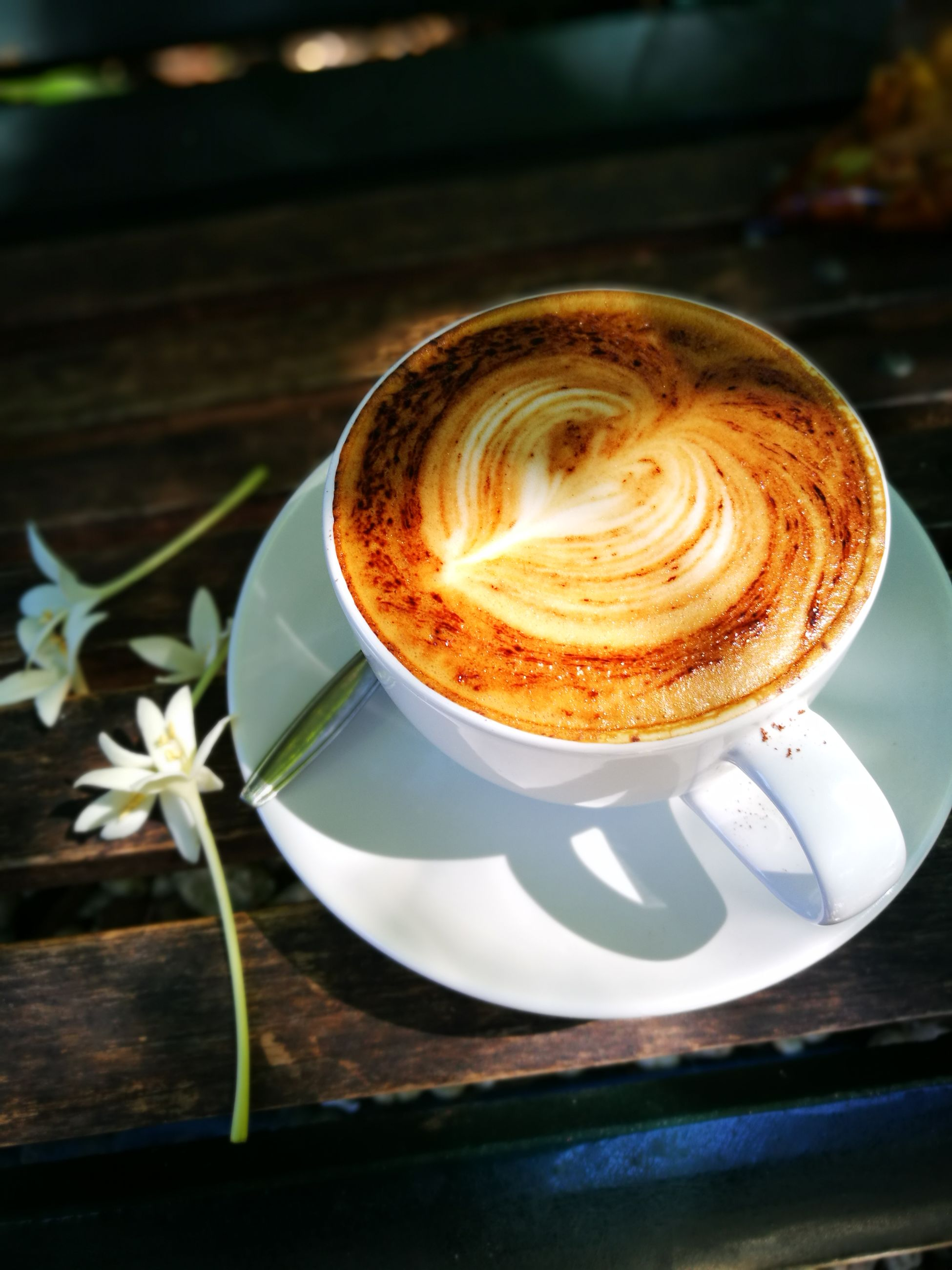 coffee - drink, coffee cup, drink, cappuccino, saucer, frothy drink, spoon, latte, cup, close-up, froth art, brown, food and drink, no people, espresso, refreshment, table, coffee break, indoors, mocha, freshness