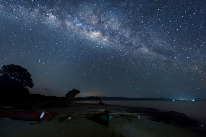 milky way rise above trees Star - Space Astronomy Night Sky Space Galaxy Scenics - Nature Beauty In Nature Nature Star Star Field Milky Way Land Infinity Water Tranquil Scene Tranquility Constellation Beach People