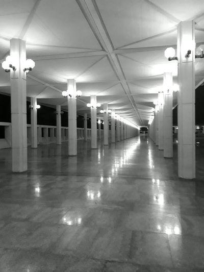 Balck And White Pillars Light Bulbs Pattern Symmetry Nightphotography Marbledstone Illuminated Architectural Column Corridor Architecture
