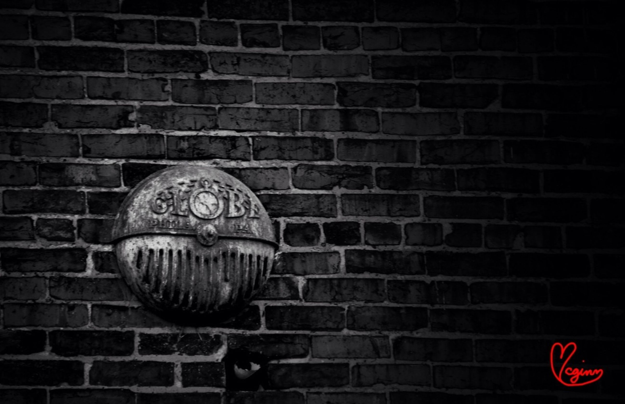 brick wall, wall - building feature, text, red, close-up, communication, pattern, wall, western script, no people, old, built structure, outdoors, day, art and craft, metal, circle, architecture, old-fashioned, design