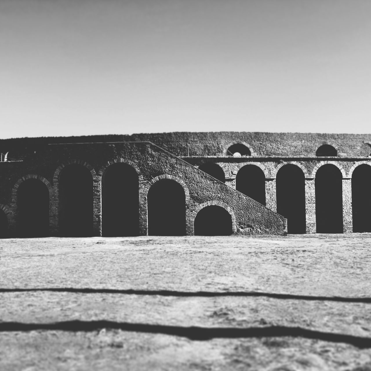 arch, architecture, built structure, in a row, clear sky, outdoors, no people, day, history, ancient, bridge - man made structure, travel destinations, building exterior, ancient civilization, sky, nature