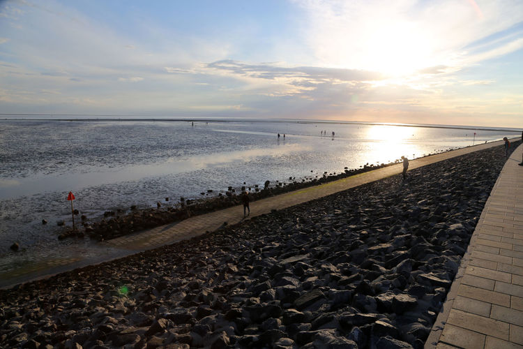 Büsum dyke at sunset, Dithmarschen, Germany Büsum Deich  Sky And Clouds Beach Beauty In Nature Bird Buesum Buesum Germany Day Dyke  Horizon Over Water Nature No People Norther Frisia Northern Frisia Outdoors Sand Scenics Sea Sky Sunset Tranquil Scene Tranquility Water