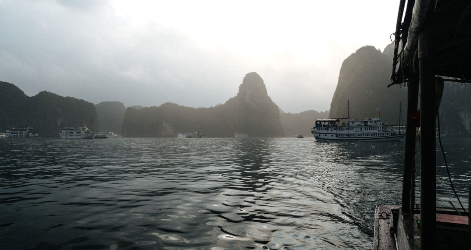 Sun rise over Ha Long Bay, Vietnam ASIA Bay Beauty In Nature Boat Day Landscape Landscape_Collection Landscape_photography Mode Of Transport Mountain Nature Nautical Vessel No People Outdoors Scenics Sky Sun Sunrise Tranquility Transportation Travel Destinations Vietnam Vietnamese Water Waterfront