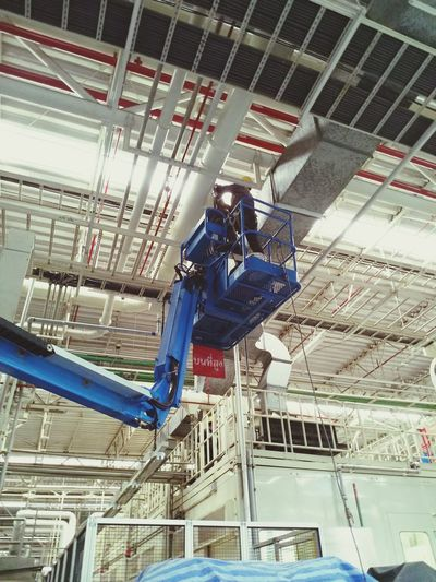 Low angle view of man working at construction building