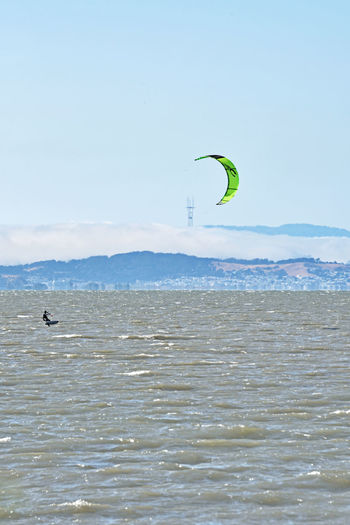 Kiteboarding In San Mateo 10 San Francisco Bay Sutro Tower Kite Surfing Kitesurfer Kiteboarding Fog Marine Layer Hills Of San Francisco Aquatic Sports Colorful Sails Wind Power Gusty Wind Sail Power Water Sports Foggy Day Enjoying Life