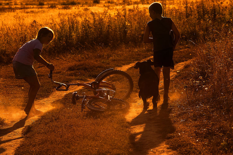 Children playing on dirt road