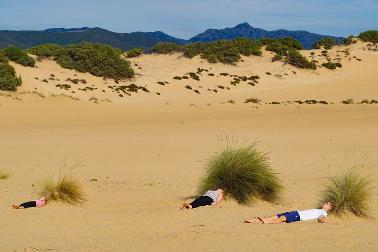 Big hair family relaxing on the beach Land Sand Nature Beach Real People The Creative - 2018 EyeEm Awards Leisure Activity People Lifestyles Mountain Outdoors Tranquility Plant Sky Beauty In Nature Sunlight Day