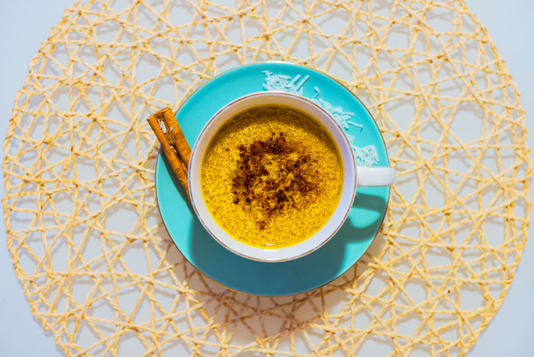 Turmeric tea in a cup with a saucer Coffee Cup Crockery Cup Directly Above Drink Food And Drink High Angle View Hot Drink Indoors  Mug No People Refreshment Saucer Still Life Table Tea Tea Cup