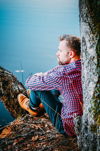 Real People Nature Casual Clothing Young Men Leisure Activity One Person Sitting Day Tree Lifestyles Young Adult Water Tree Trunk Trunk Plant Outdoors Contemplation Full Length Men Passion Nikon Good Morning Lake Poland The Week on EyeEm
