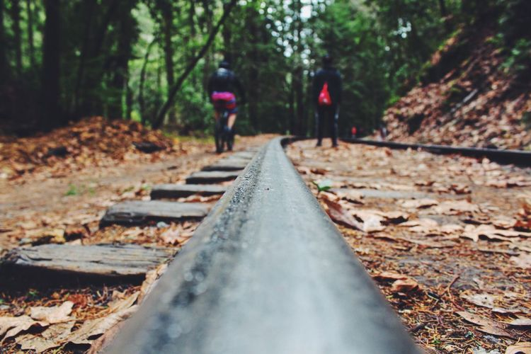 A biker and a hiker Bike Ride Biker On Your Bike Hiking Hikingadventures Train Tracks Trail Santa Cruz Bay Area Focus On Foreground