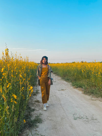 Full length of woman walking on land against clear sky
