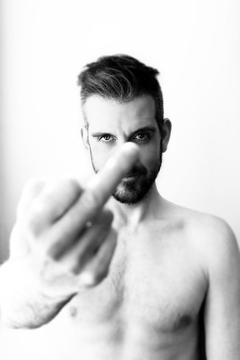Self Portrait, flipping the bird. Adult Angry ANGST Beard Close-up Emotion Flipping The Bird Gesturing Handsome Headshot Human Body Part Human Hand Looking At Camera Men One Young Man Only Only Men People Portrait Real People Sexyselfie Studio Shot White Background Young Adult Young Men Uniqueness TCPM The Portraitist - 2017 EyeEm Awards