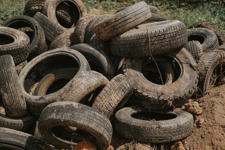 Close-up of abandoned tires at junkyard