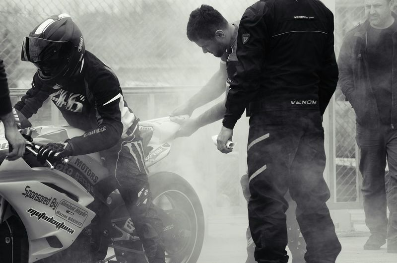 Before the race, all the team members are working... Learn & Shoot: Layering EyeEm Best Shots - Black + White Sony A330 Blackandwhite Streetphoto_bw Streetphotography Drag Racing Motorbike Capture The Moment
