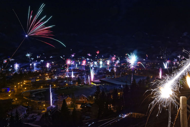 EyeEmNewHere Night Sky Illuminated Celebration Event Outdoors No People Firework Display Firework Firework - Man Made Object Cityscape New Year Blaichach