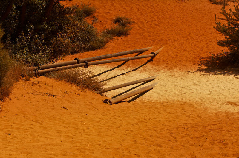 High angle view of deck chairs on sand