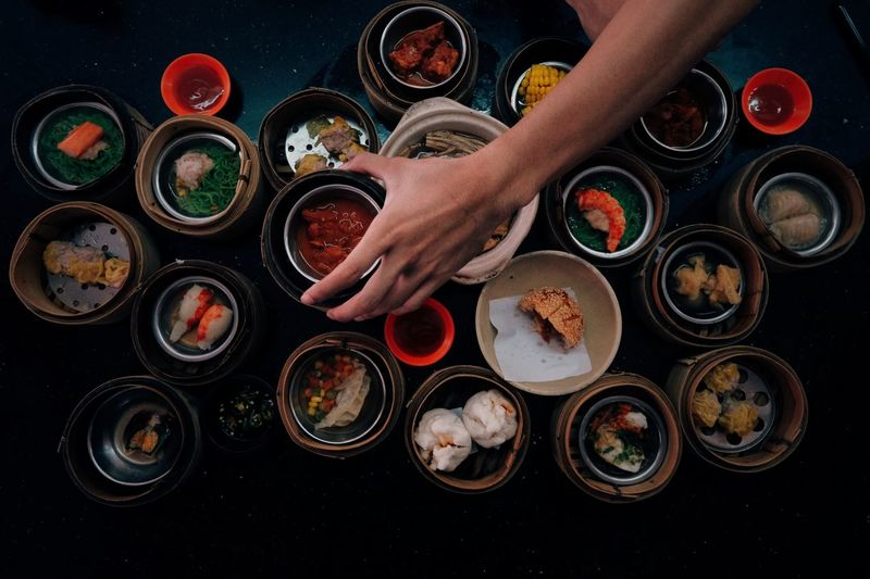 Bowl Choice Container Directly Above Finger Food Food And Drink Freshness Hand High Angle View Holding Human Body Part Human Finger Human Hand Human Limb Indoors  One Person Real People Table Unrecognizable Person