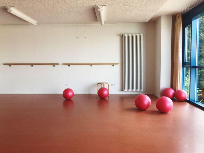 Fitness balls on hardwood floor in gym
