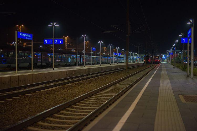 Railroad station platform at night