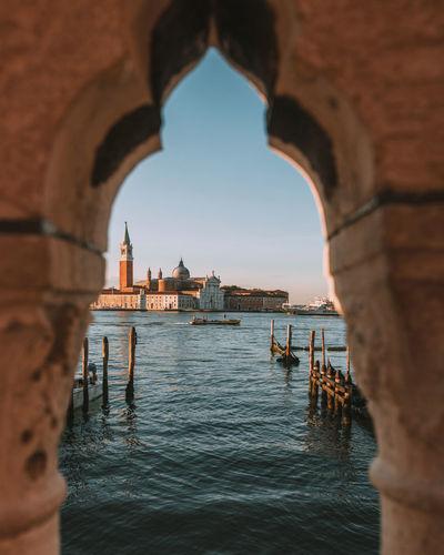 Sea seen through arch of building