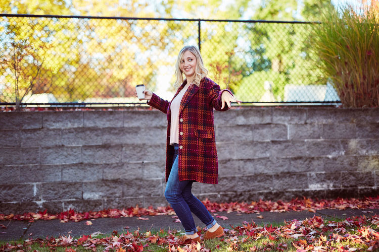 Adult Adults Only Autumn Beautiful Woman Blond Hair Casual Clothing Day Full Length Leaf Looking At Camera Mature Adult Nature One Person One Woman Only One Young Woman Only Only Women Outdoors People Portrait Red Smiling Standing Women Young Adult Young Women