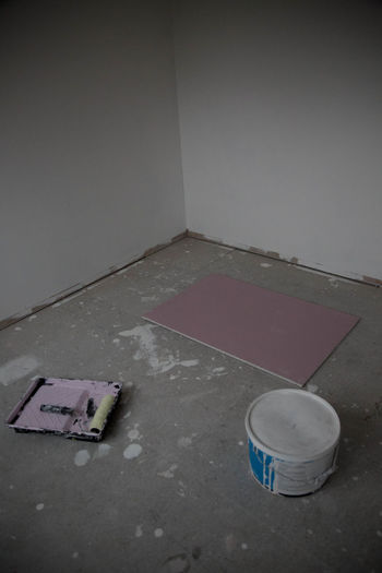Abandoned Absence Architecture Close-up Damaged Dirty Domestic Room Empty Flooring High Angle View Home Interior Indoors  Messy Minimal No People Old Sport Still Life Wall Wall - Building Feature White Color
