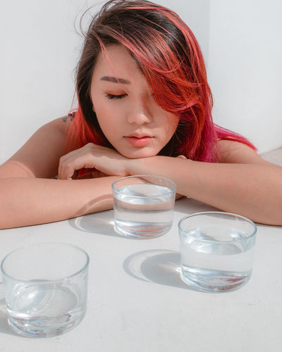 three wishes Light Light Refraction Young Women Water White Background Women Human Hand Headshot Sitting Human Face Redhead Drinking Glass Dyed Red Hair Introspection Thoughtful Day Dreaming Thinking