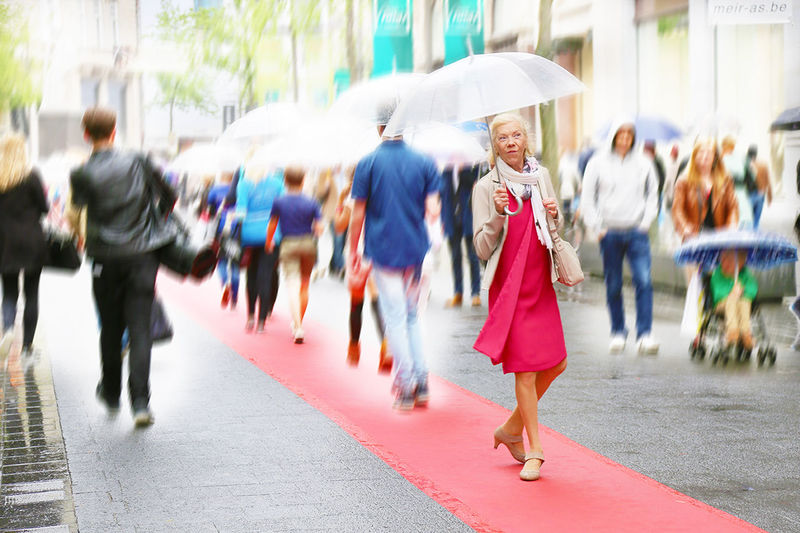 Blurred Motion Casual Clothing Depth Of Field Enjoyment Fashion Show Friendship Full Length Holding Leisure Activity Lifestyles Meir Occupation Old Woman Raining Real People Rear View Selective Focus Standing Street Fashion Streetphotography Togetherness Umbrella Walking Women