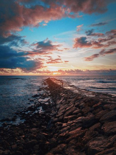 Sunset And Clouds  Sunset Water Sky Sea Beauty In Nature Scenics - Nature Sunset Cloud - Sky Tranquility Tranquil Scene Land Nature Beach Horizon Outdoors Sunlight Horizon Over Water Capture Tomorrow
