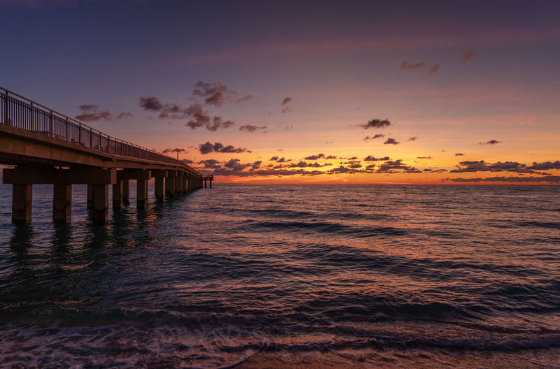 Sunny Isles beach sunrise Water Sea Sunset Architecture Scenics - Nature Beauty In Nature Orange Color Beach Horizon Over Water Nature Tranquil Scene Tranquility No People Miami Miami Beach Sunny Isles Beach Sunrise Clouds Jetty Pier Seascape Landscape