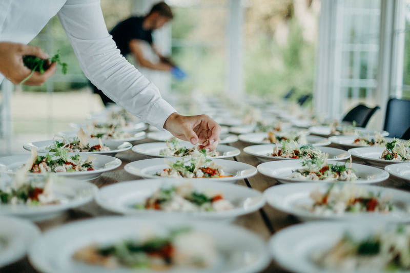 Preparing the wedding meal for the newlyweds. Photos taken during a wedding in Copenhagen, Denmark. Hands Food Restaurant Buffet Wedding Wedding Photography Wedding Ceremony Wedding Day Wedding Reception Wedding Food Wedding Dinner Food And Drink Selective Focus Table Freshness Indoors  Preparing Food Plates Conference Room Reception Many People Event Photography One Person Hand Preparation  Occupation Business Human Hand Chef Real People Human Body Part Adult Working Day Uniform