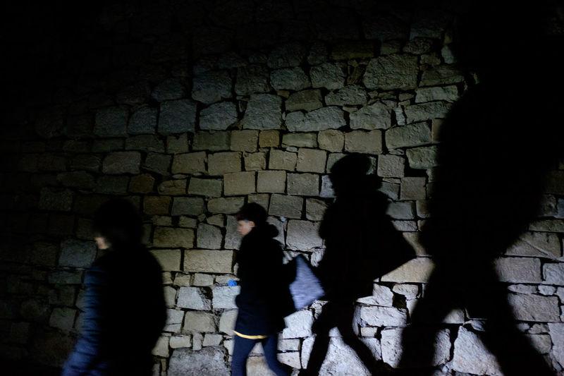 Shadow of woman in dark room