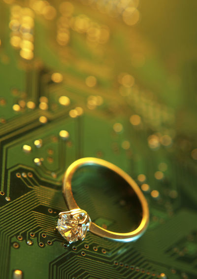 Close-up of diamond ring on computer chip