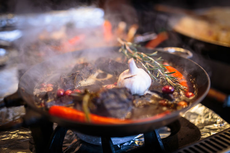 Street food Flame Heat - Temperature Seafood Smoking - Activity Burning Vehicle Breakdown Smoke - Physical Structure Stir-fried Coal Prepared Food Barbecue Grilled