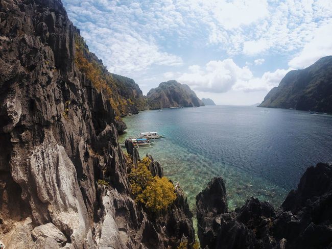 Beauty In Nature Cliff Cloud - Sky Day Mountain Mountain Range Nature No People Outdoors Palawan Physical Geography Rock - Object Rock Formation Scenics Sea Sky Tranquil Scene Tranquility Water
