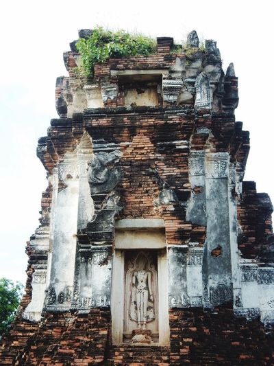 Religion Sculpture Statue Architecture Travel Destinations Tourism Spirituality Built Structure Low Angle View Old Ruin No People Day Building Exterior Outdoors Ancient Civilization Lopburi Thailand