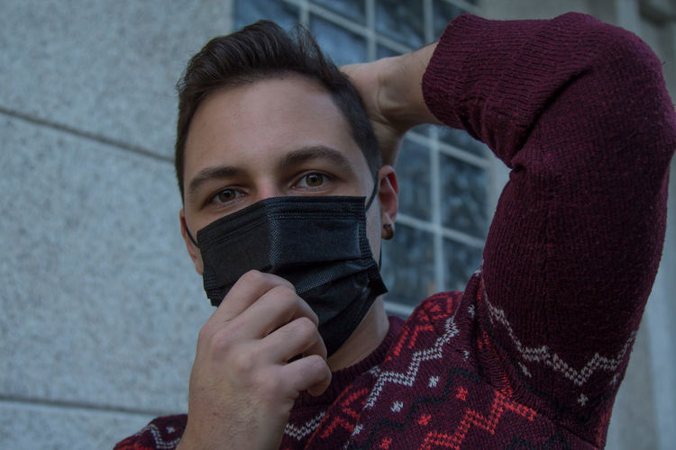 Young man with mask on the street