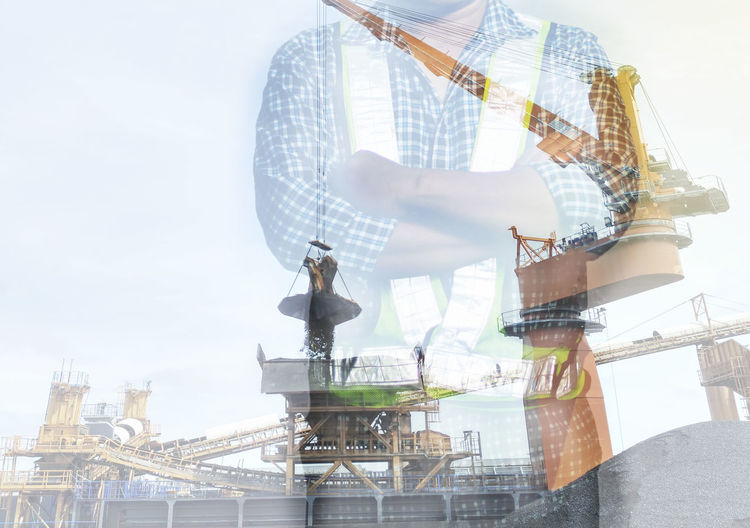 Worker crossed his hand industrial floating crane double exposure concept Adult People One Man Only Only Men Businessman One Young Man Only One Person Adults Only Engeneering Industry Portrait